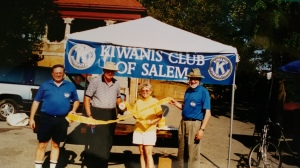 Salem Kiwanis booth at Easter egg hunt featuring four members.