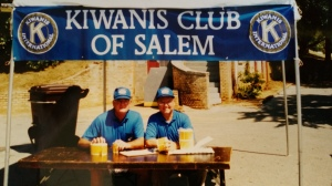 Salem Kiwanis booth with two of our members providing popcorn to the Easter Egg hunters.