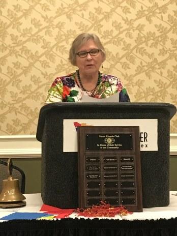 Salem Kiwanian Eileen Bell introducing Salem Police Department Honoree
